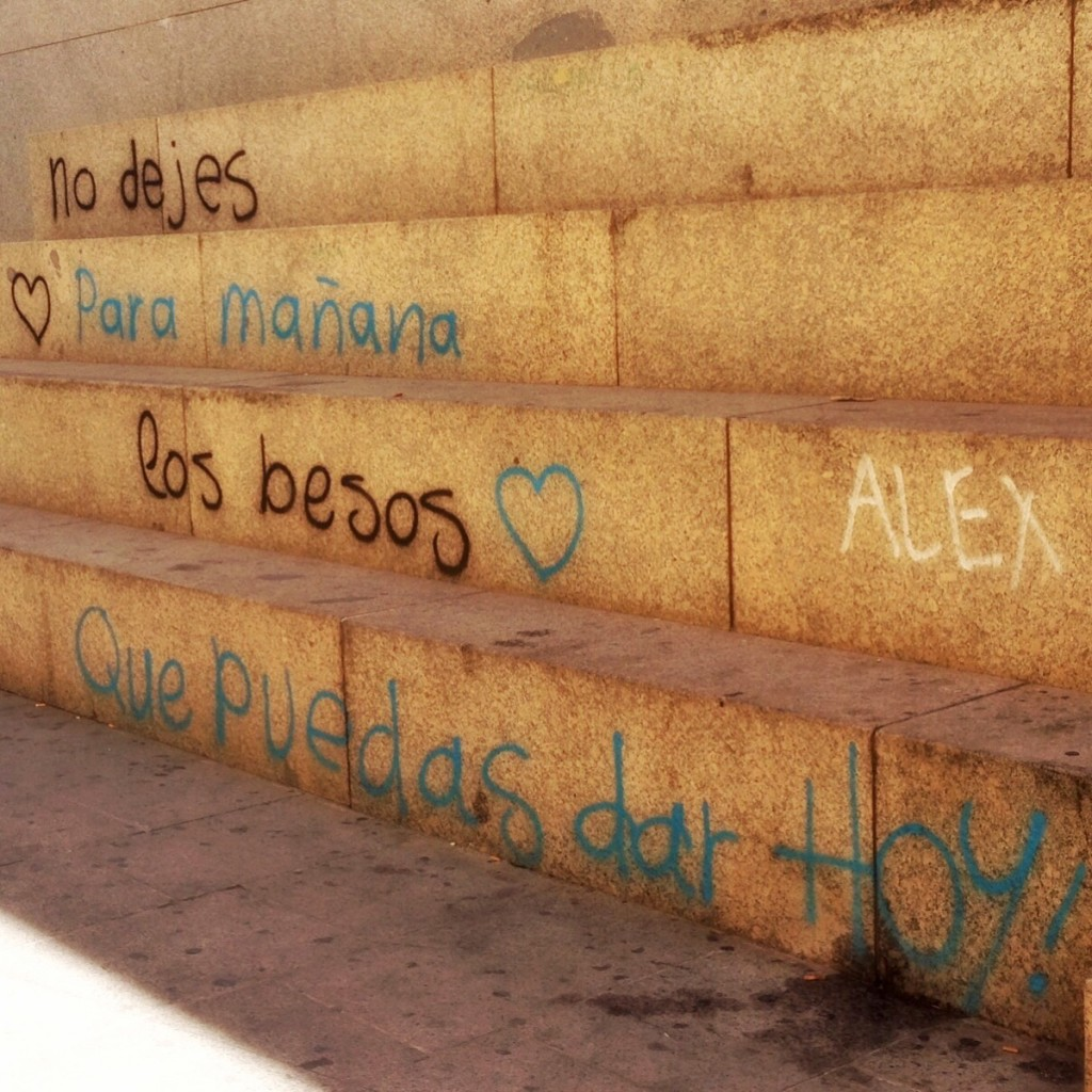 "Outside the train station. Translation: ""Don't leave for tomorrow the kisses you can give today."" Córdoba"