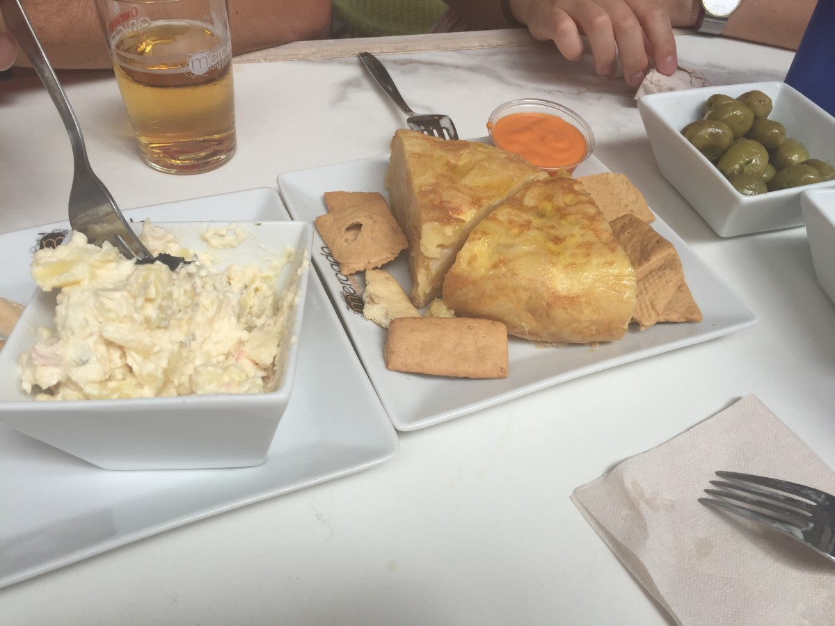 Russian salad, Spanish tortilla and olives. Sevilla