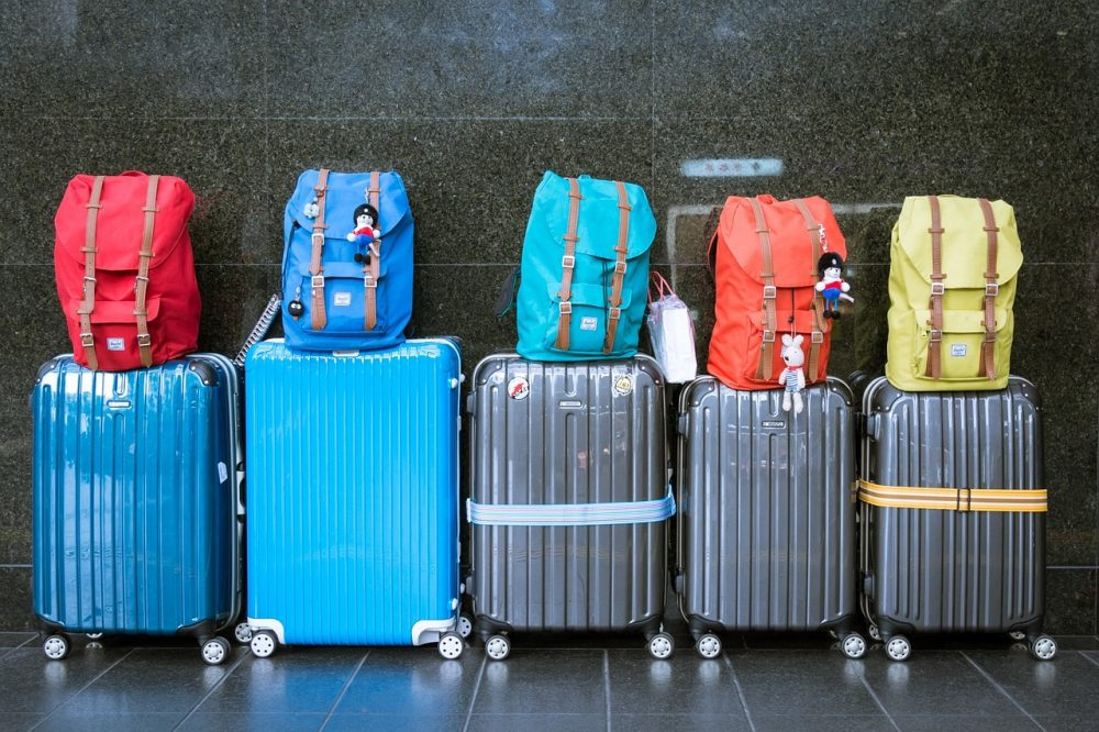 How To Pack Light For Winter Travel In A Carry On Passport Plates